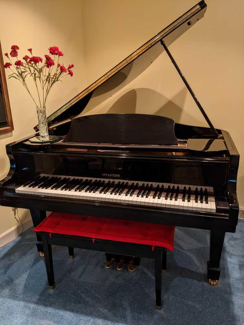 Ebony finish baby grand piano